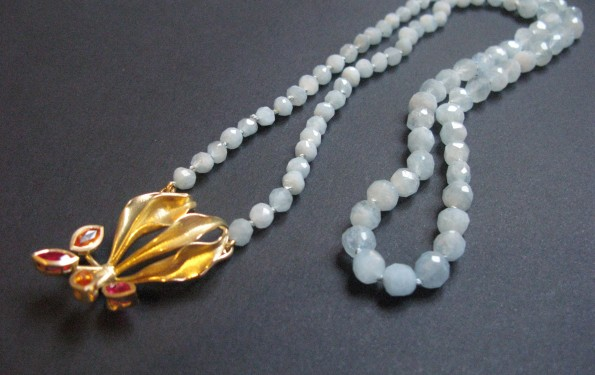 Flame Lily Necklace with aquamarine, 18carat gold pendant with two ruby and two sapphire