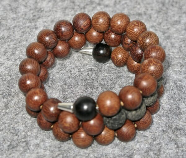 Bracelet. Wood beads and Lava beads on a memory wire. You can add essential oil of you choice on the lava beads.